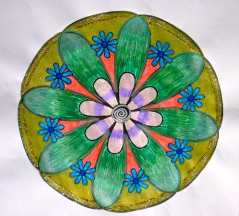 Flowering : Coloured into printed out mandala. (Pens and marker pens)
