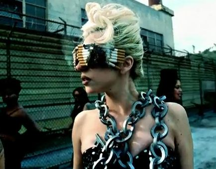 I now have this priceless picture of Lady Gaga with cigarette sunglasses and chains nestled together with images of mandalas. Now, is that  being open minded or what? Smoke Gets in your Eyes anyone? hehe (Click image for source)
